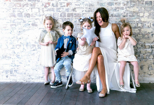 A picture of Sydney PR expert Sarah Cicy laughing with children.